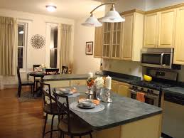 kitchen island eating area flooring kitchen island with dark countertop plus iron bar stool