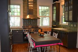 sweet home charlotte pushing forward lizanne shaver redefines design instead of the traditional island the kitchen table and vintage chairs give the feeling of being privilege to an elite chef s tasting