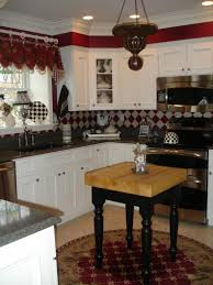 cheap black kitchen appliances fake wood flooring idea in brown