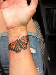 awesome orange winged monarch butterfly wrist tattoos tattoomagz
