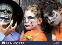 children outside boy disguise halloween celebration make up
