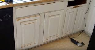 how to paint particle board cabinets how to repair water damaged kitchen cabinets