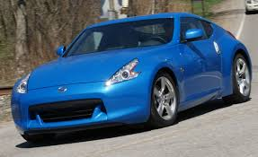 nissan sports car blue 2009 nissan 370z touring long term road test update reviews