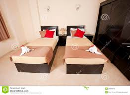 twin beds in a bedroom stock photos image 20695843
