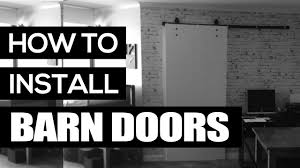 How To Hang A Barn Door by How To Install A Barn Door Youtube