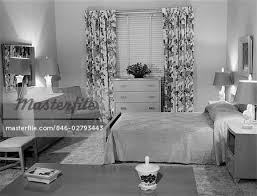 1950s bedroom 1950s bedroom interior with floor length floral curtains venetian