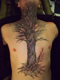 large black tree and skull on chest and abdomen tattoos for