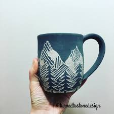 sgraffito mountain mug by turned to stone design pottery