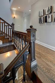 dark brown polished wooden staircase with brown wooden handrail