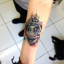 camera watercolor tattoo on forearm