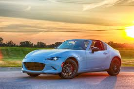 mazda sporty cars old and new mazda miatas demonstrate why driving matters