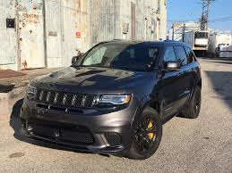 jeep cherokee yellow driving the 707 horsepower jeep grand cherokee trackhawk in a word