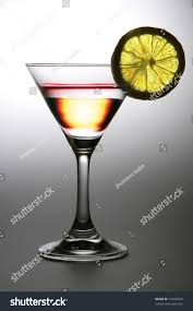 martini transparent alcoholic cocktail tall wine glass transparent stock photo