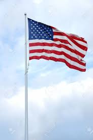 Flag Pole Express American Flag On Flag Pole Undulating In The Wind Stock Photo