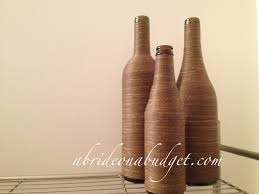 how to decorate a wine bottle for a gift diy twine wrapped wine bottle centerpieces tutorial a on