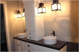 brown finish maple wood storage vanity cabinet black towel beside