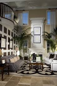 Elegant Living Room Color Schemes by 2 Story Great Room With White Fireplace Mezzanine Looking Down On
