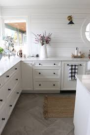 pictures of kitchen floor tiles ideas email post kitchens black cabinet and wood planks