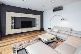 Apartment Living Room Design Ideas by Cream U Shaped Sectional Sofa With Rug And Wall Lights For Living