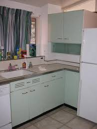 How To Refinish Metal Kitchen Cabinets Hunker - Metal kitchen cabinets