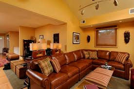 italian living room ideas using brown leather sectional sofa for