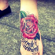 rose surrender nothing traditional tattoo on foot