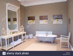 Bathroom Group Freestanding Roll Top Bath Below Group Of Fruit Paintings In Gray