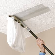 you can attach a plastic bag this popcorn ceiling scraper from