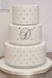 white quilted wedding cake with diamantes brooch and bow with