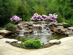 traditional landscape yard with stacked stone waterfall exterior