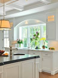 exciting kitchen designs with window over sink treatments on home