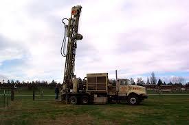 drilling holes for hop trellis poles smith rock hop farm
