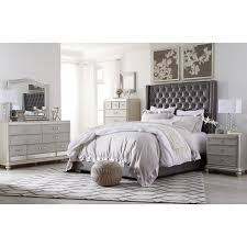queen upholstered bed with tall headboard with faux crystal