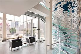 amazing staircase design with watery blue glass step and iron