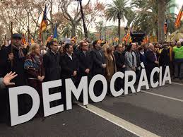 thousands take to the streets as catalan parliament speaker faces