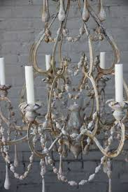 Chandelier Accessories Accessories Modern Wood Bead Chandelier With Wall Art And Sofa