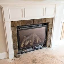 Ash Can For Fireplace by Gas Log Vs Wood Fireplaces