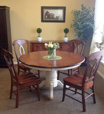 two toned dining room table white base stained top and chairs
