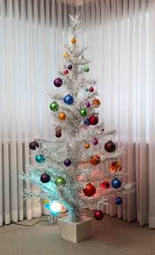 why an aluminum monstrosity replaced our real tree