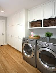 contemporary laundry room design with white laundry room cabinets