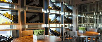 biltmore at camelback apartments in phoenix az wine room with temperature controlled resident wine storage bar station and seating for events