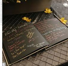 guest book with black pages instead of a traditional guest book for a destination wedding