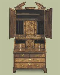 bureau vall agathon a george i walnut and figured walnut bureau cabinet circa 1715 d5328435g jpg