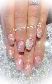 sculpted bridal acrylic nails with freehand lace design and
