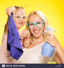 mother and daughter clean the house stock photo royalty free
