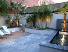 courtyard feature with timber highlights and night time lighting