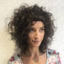 women u0027s messy textured curly with micro bangs on brunette