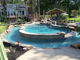 Backyard Pool Pictures The Natural Boulder Waterfall Of This Lagoon Style Pool Definitely