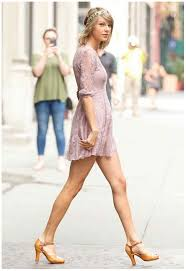 taylor swift wore purple lace short dress show off bare legs in