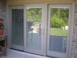 exterior design pella doors and windows on tan wall matched with